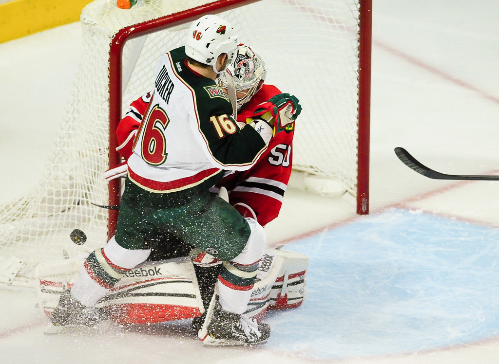 . Minnesota Wild left wing Jason Zucker collides with Chicago Blackhawks goalie Corey Crawford in overtime. (Pioneer Press: Ben Garvin)