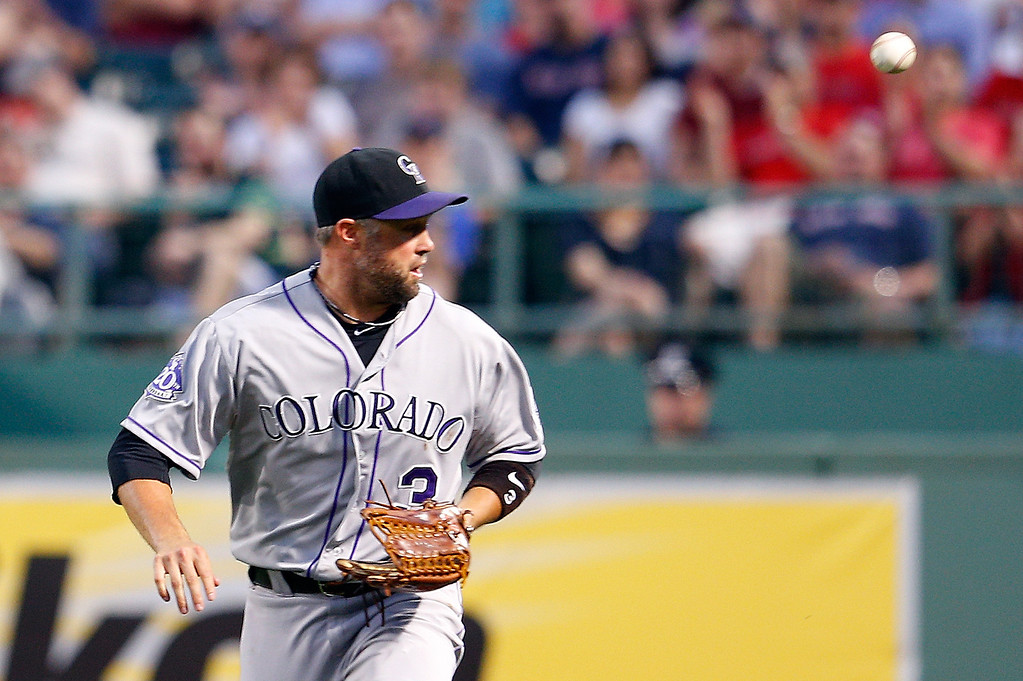 . Michael Cuddyer #3 of the Colorado Rockies has trouble handing a ball hit by Shane Victorino #18 of the Boston Red Sox in the 3rd inning at Fenway Park on June 25, 2013 in Boston, Massachusetts.  (Photo by Jim Rogash/Getty Images)