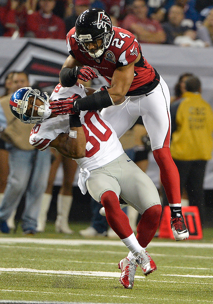 . Atlanta Falcons strong safety Chris Hope (24) hits New York Giants wide receiver Victor Cruz (80) during the second half of an NFL football game on Sunday, Dec. 16, 2012, in Atlanta. (AP Photo/Rich Addicks)