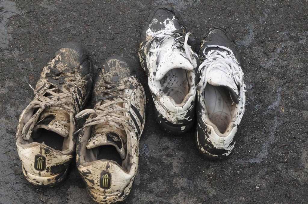 . A crew from Jet-Black change to dirty shoes when resealing Opal and Bob Kuehn\'s driveway in St. Paul.  (Pioneer Press: Jean Pieri)