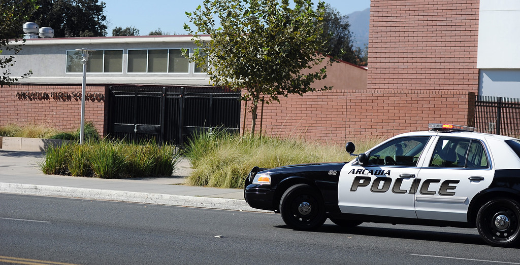 . Arcadia Police unit sits in front after a lockdown at Arcadia High School in Arcadia, Calif. on Thursday, Sept. 12, 2013.   (Photo by Keith Birmingham/Pasadena Star-News)