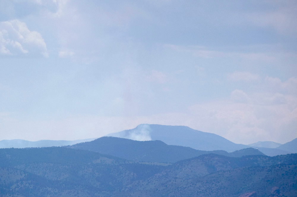 . A fire burns near Evergreen, Colorado, as seen from Denver on June 3, 2013. The Jefferson County Sheriff\'s Office ordered evacuations within one mile of Bluebell Lane. (Photo by Daniel Petty/The Denver Post)