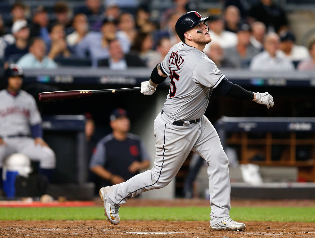 . Cleveland Indians\' Roberto Perez connects for a solo home run against the New York Yankees during the fifth inning in Game 4 of baseball\'s American League Division Series, Monday, Oct. 9, 2017, in New York. (AP Photo/Kathy Willens)