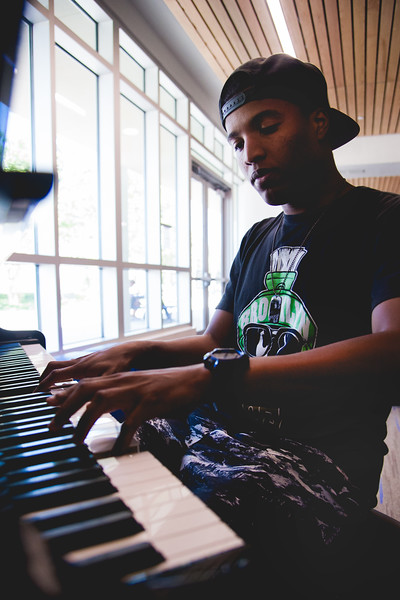 Eric Avery plucks away on the UC piano during the quiet of the afternoon.