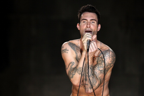 ". LOS ANGELES, CA - JULY 08:  Musician Adam Levine of the band Maroon 5 performs at the Maroon 5 Video Shoot for ""Moves Like Jagger\"" with Christina Aguilera on July 8, 2011 in Los Angeles, California.  (Photo by Christopher Polk/Getty Images for A&M/Octone)"
