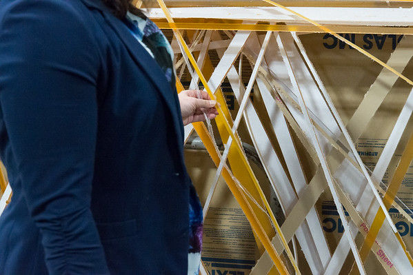 02/15/19 Wesley Bunnell | Staff Mayor Erin Stewart looks over scrap colored plexiglass which was used to build trim pieces for the outside of the Beehive Bridge project in New Britain. Stewart visited the manufacturer, Sign Pro, along with other city employees on Friday for a project update.