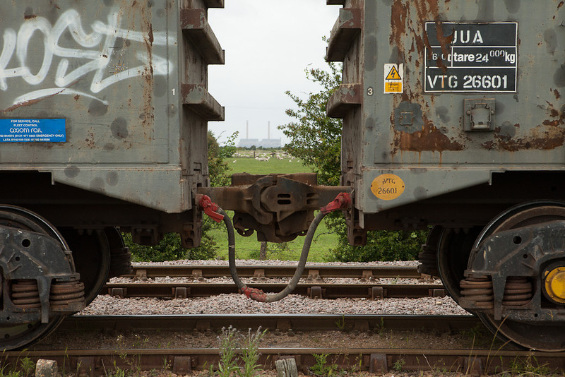 Automatic couplers on the 7U71 (13:31 Cliffe-Stewarts Lane sand in bogie box wagons) in Cliffe, Kent.