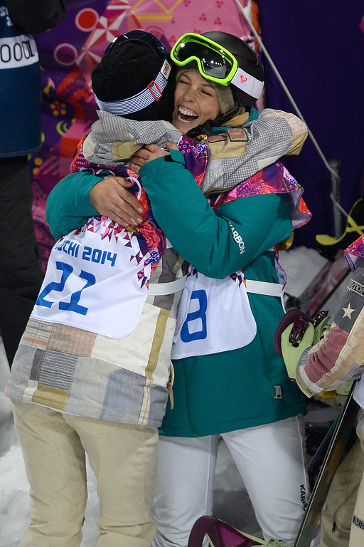 . Silver medalist Torah Bright of Australia hugs American gold medalist Kaitlyn Farrington during a women\'s snowboard halfpipe final at the Rosa Khutor Extreme Park. Sochi 2014 Winter Olympics on Wednesday, February 12, 2014. (Photo by AAron Ontiveroz/The Denver Post)