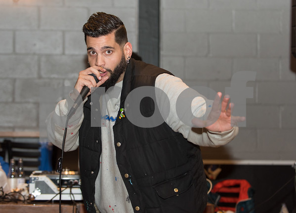 12/01/17 Wesley Bunnell | Staff The fourth annual Hip Hop for the Homeless benefit organized by Joe Battaglia was held at Alvarium Beer Co. on Thursday evening. Joe Battaglia making an announcement to the crowd.