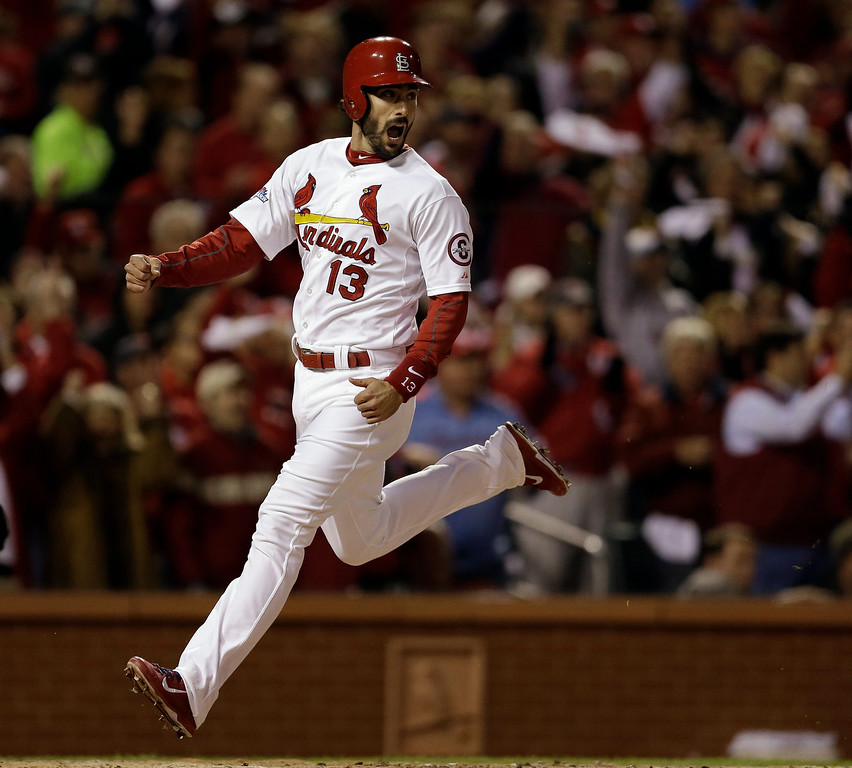 . St. Louis Cardinals\' Matt Carpenter celebrates after scoring from second on a hit by Carlos Beltran during the third inning of Game 6 of the National League baseball championship series against the Los Angeles Dodgers, Friday, Oct. 18, 2013, in St. Louis. (AP Photo/Jeff Roberson)