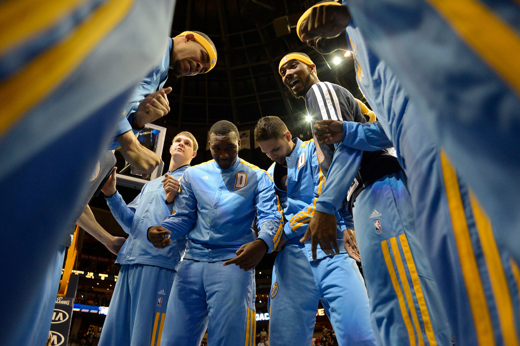 . Denver Nuggets huddle to start the game against the Orlando Magic Wednesday, January 9, 2013 at Pepsi Center. John Leyba, The Denver Post