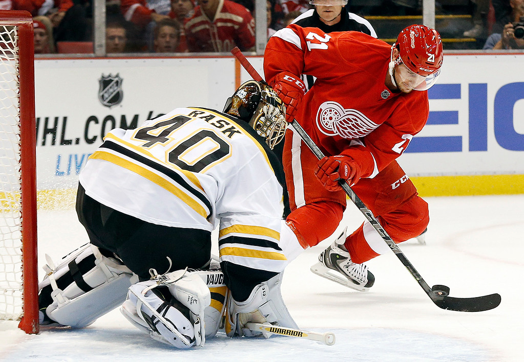 . Boston Bruins goalie Tuukka Rask (40) stops a shot by Detroit Red Wings left wing Tomas Tatar (21) in the second period of an NHL hockey game in Detroit Thursday, Oct. 9, 2014. (AP Photo/Paul Sancya)