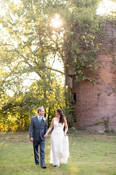 barn-silo-bride-groom-walking.jpg