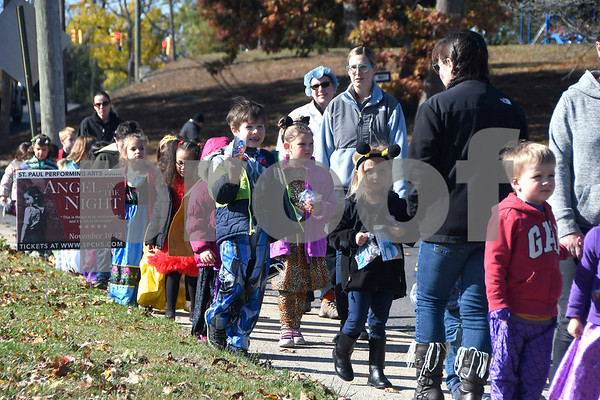 10/31/2017 Mike Orazzi | Staff St. Joseph School costumed students on their way from the Bristol Public Library back to the school Tuesday morning.