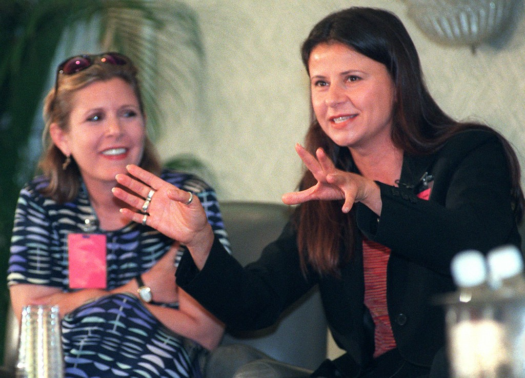 """. Actress Tracey Ullman, right, gestures while Carrie Fisher looks on during the \""""Make \'Em Laugh\"""" workshop Sunday, June 1, 1997 in Santa Monica, Calif.  Ullman and Fisher talked about how to \""""Make \'Em Laugh\"""" and were part of a seven person panel. The workshop was one of several at the weekend long Writer\'s Guild conference.  (AP Photo/Chris Urso)"""