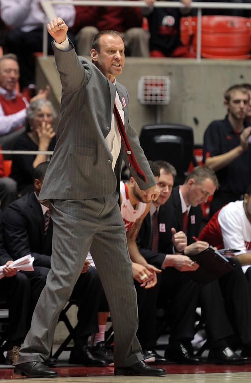 . Utah coach Larry Krystkowiak shouts instructions to his team in the second half during an NCAA college basketball game against Colorado on Saturday, Feb. 2, 2013, in Salt Lake City. Utah won 58-55. (AP Photo/Steve C. Wilson)
