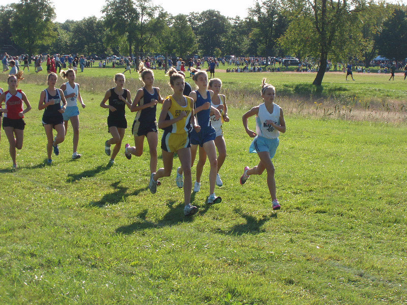 High School Cross Country meet: NordicSkiRacer Ryan Robinson couldn't make rollerskiing today because he coaches cross country for Waterford Mott. In fact, that's his star runner leading the pack in the white and light blue running outfit. (She won the race).