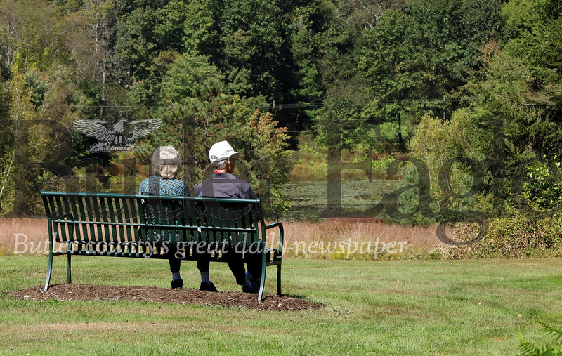 David and Nancy Blewett of Butler enjoy a break from their walk above Carrie's Pond in Preston Park Thursday. Seb Foltz/Butler Eagle