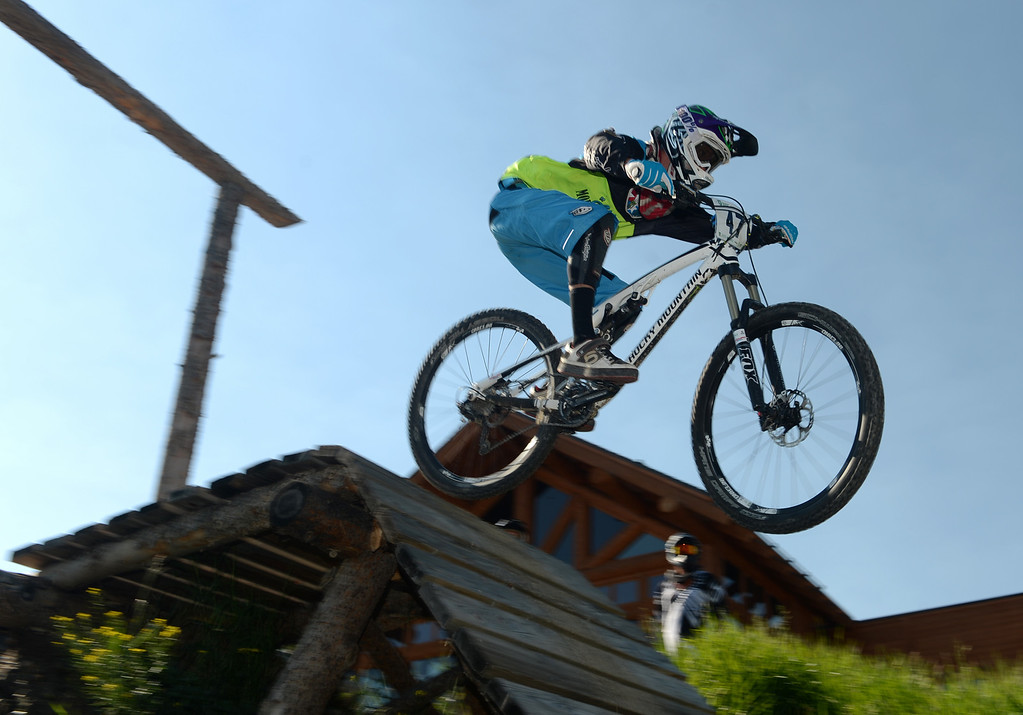 . WINTER PARK, CO. - July 26: Sam Stevens catches air after starting the first stage of First international Enduro World Cup Championship ever in U.S. at Winter Park, Colorado. July 26, 2013. (Photo By Hyoung Chang/The Denver Post)