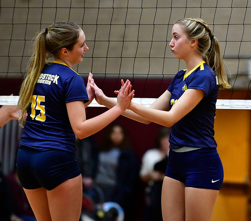 11/14/2018 Mike Orazzi | Staff Woodstock Academy's Samantha Orlowski (15) and Amelia Large (21) during the Class L Semifinal State Girls Volleyball Tournament held at Windsor High School Wednesday night.