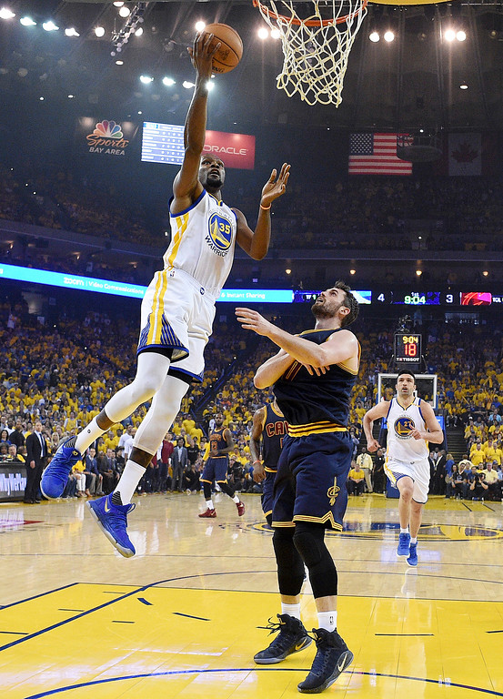 . Golden State Warriors forward Kevin Durant (35) shoots against Cleveland Cavaliers forward Kevin Love during the first half of Game 1 of basketball\'s NBA Finals in Oakland, Calif., Thursday, June 1, 2017. (Kyle Terada/Pool Photo via AP)