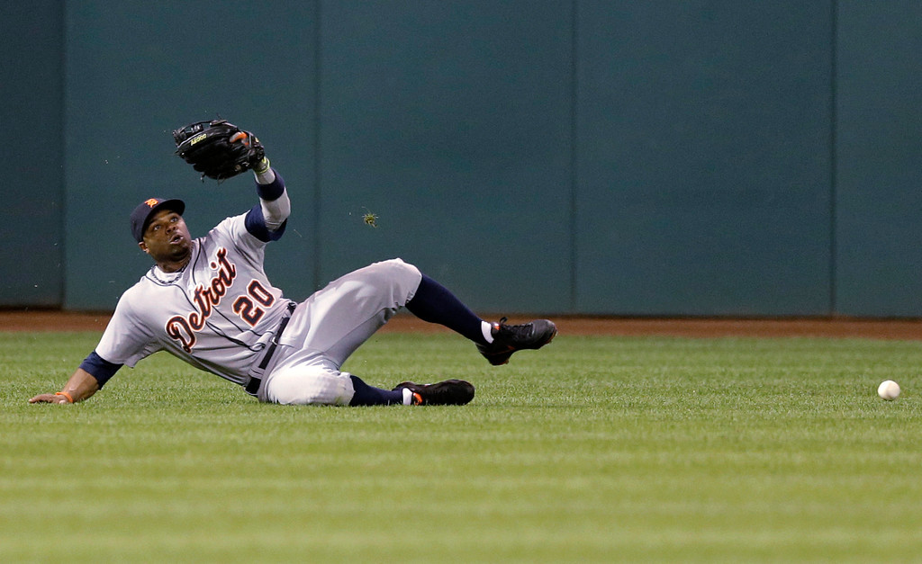 . Detroit Tigers\' Rajai Davis dives but can\'t catch a ball hit by Cleveland Indians\' Jason Kipnis in the sixth inning of a baseball game, Thursday, Sept. 4, 2014, in Cleveland. Kipnis doubled on the play. (AP Photo/Tony Dejak)