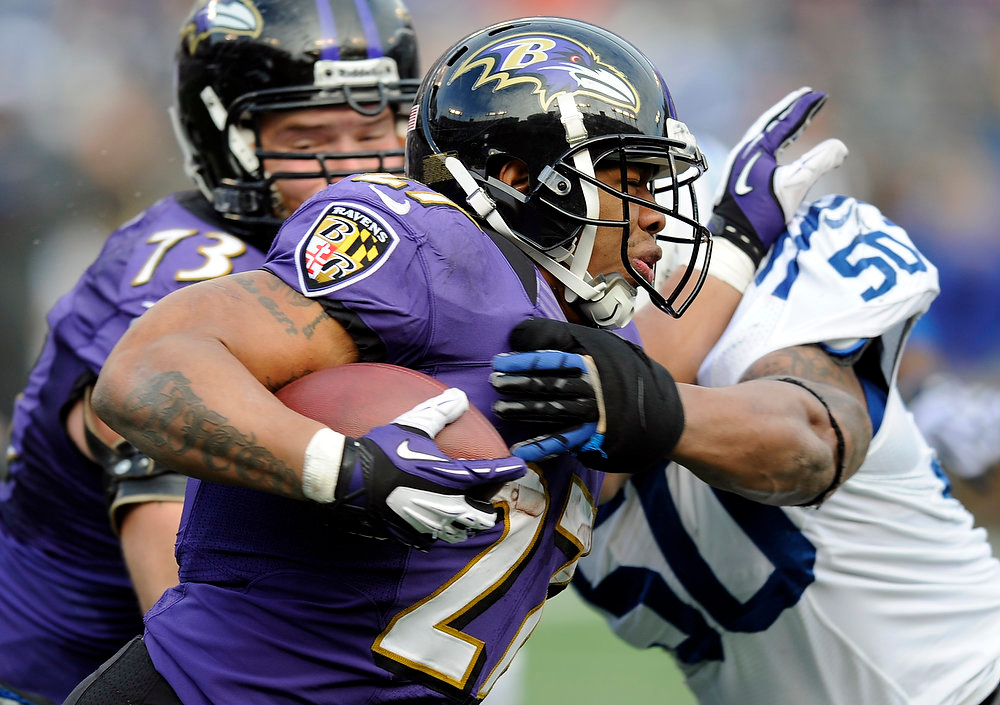 Description of . Baltimore Ravens running back Ray Rice (27) is hit by Indianapolis Colts inside linebacker Jerrell Freeman (50) during the first half of an NFL wild card playoff football game Sunday, Jan. 6, 2013, in Baltimore. (AP Photo/Nick Wass)