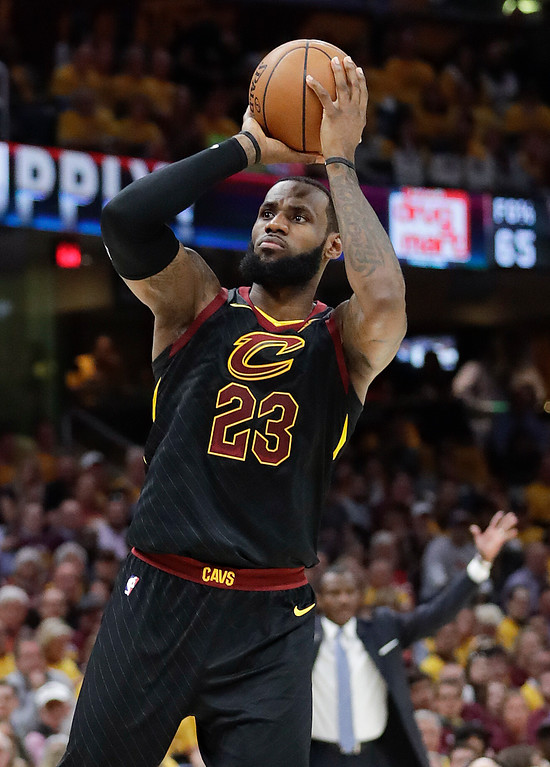 . Cleveland Cavaliers\' LeBron James shoots against the Toronto Raptors in the first half of Game 4 of an NBA basketball second-round playoff series, Monday, May 7, 2018, in Cleveland. (AP Photo/Tony Dejak)