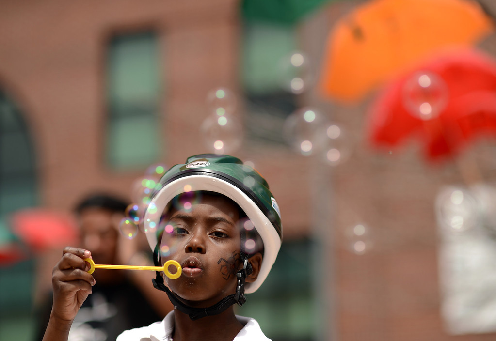 . DENVER, CO. - MAY 11 : Tyler Lewis, 6, of Denver blows bubbles at Five Points in Denver, Colorado. May 11, 2013. People are celebrating the Five Points Better Block Project at Sonny Lawson Park. The event was an opportunity for The Five Points Better Block Project to demonstrate potential improvements for the neighborhood and provide tips to promote a stronger community. (Photo By Hyoung Chang/The Denver Post)