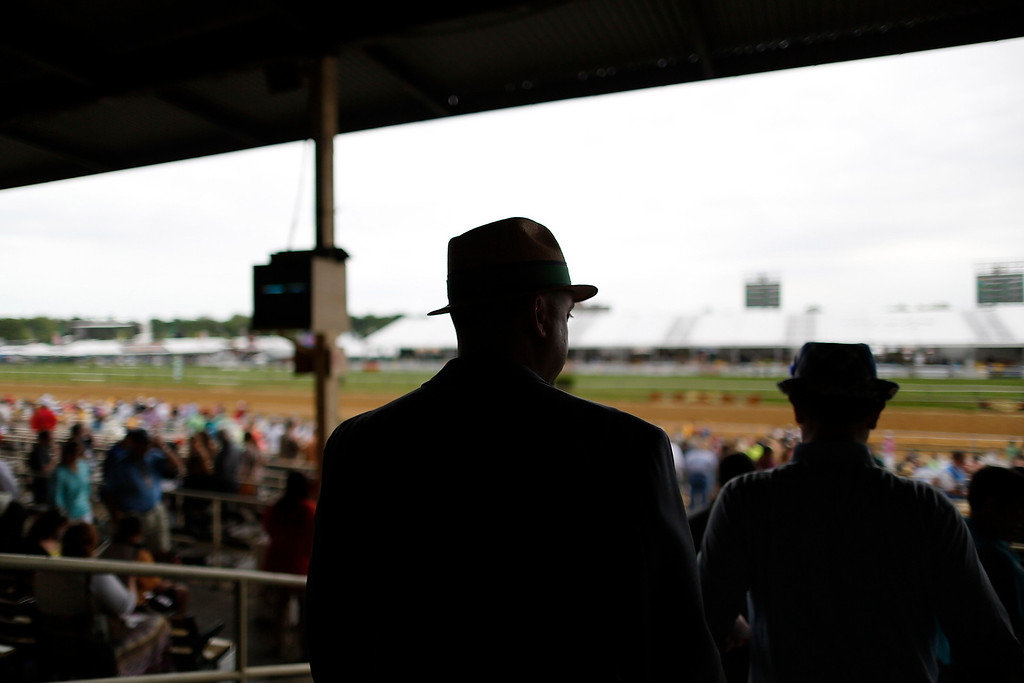 . Men in throwback hats arrive at old wooden stands before the 138th running of the Preakness Stakes at Pimlico Race Course in Baltimore, Maryland, May 18, 2013. REUTERS/Jonathan Ernst