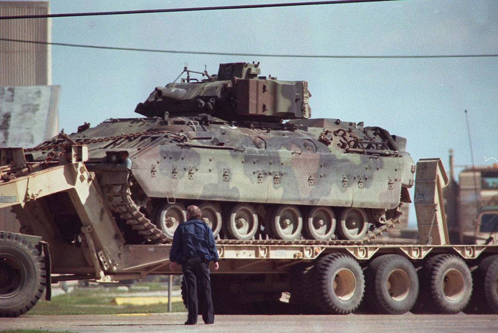 . A law enforcement official watches as an armored personnel carrier is deployed from the command center at the Texas State Technical College campus in Waco, Texas in this March 1993  photo.  (AP Photo)