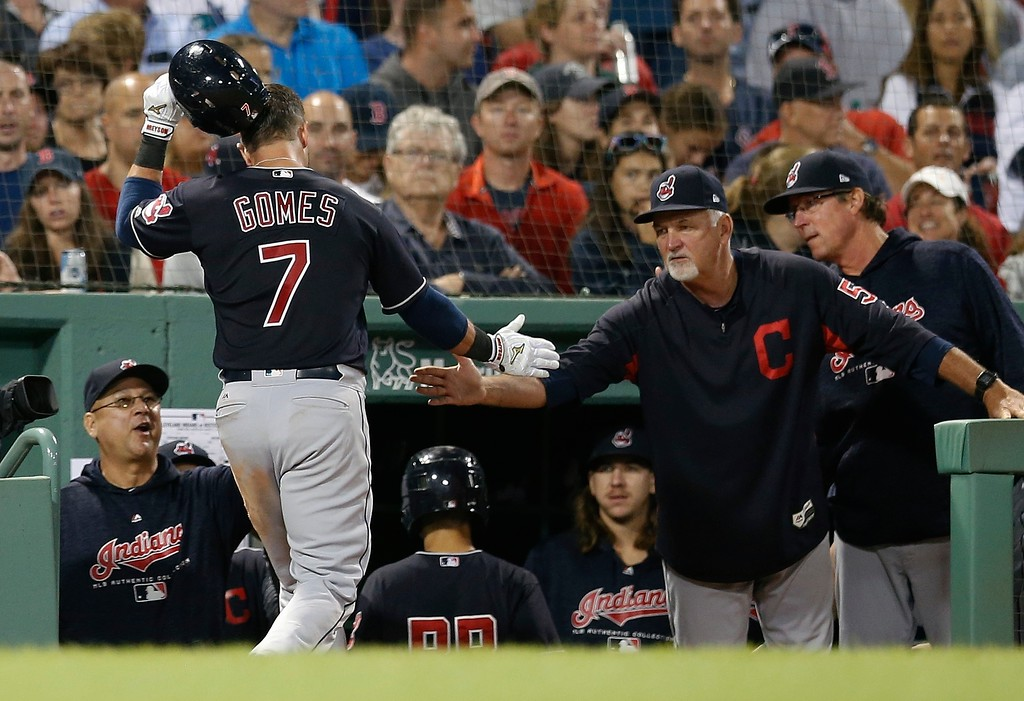 . Cleveland Indians\' Yan Gomes (7) celebrates his solo home run during the eighth inning of a baseball game against the Boston Red Sox in Boston, Tuesday, Aug. 21, 2018. (AP Photo/Michael Dwyer)