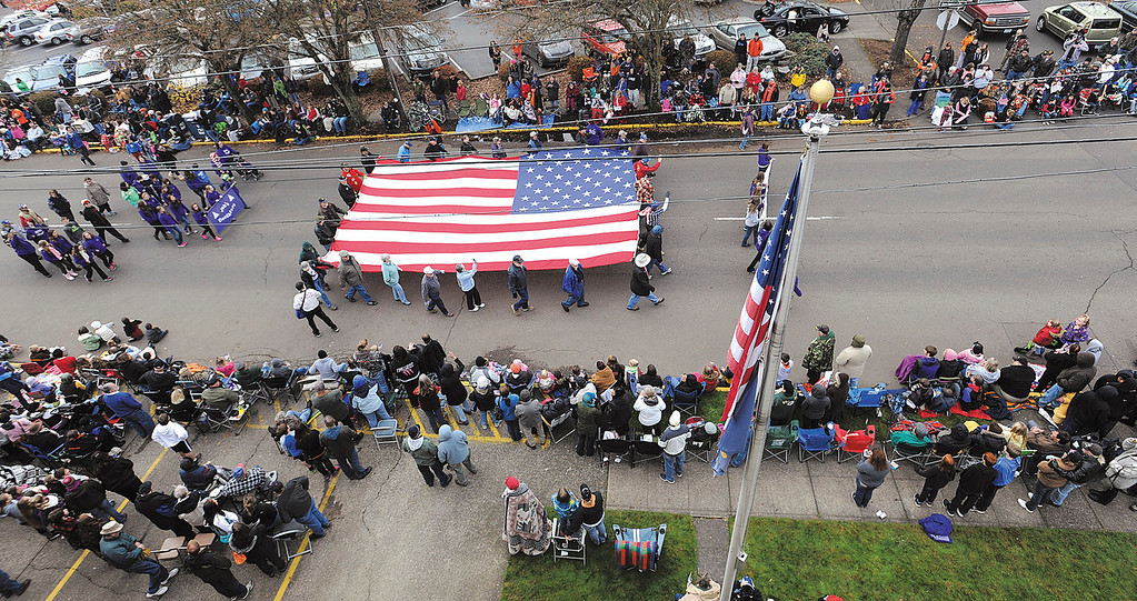 . Members of the Willamette Valley Military Masons parade their 20- by 30-foot flag along the Linn County Veterans Day parade route for the 19th straight time Monday Nov. 11, 2013. The flag once flew on top of the Fremont Bridge in Portland, Ore. (AP Photo/Albany Democrat-Hearld, Mark Ylen)