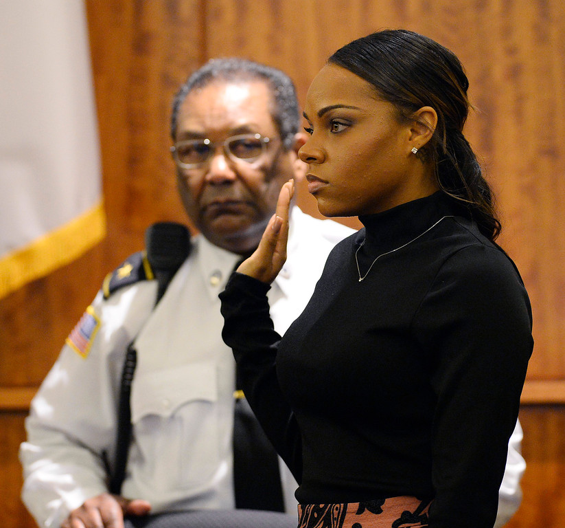 . Shayanna Jenkins, fiancee of former New England Patriots football player Aaron Hernandez, is sworn in before she testifies during his murder trial, Friday, March 27, 2015, in Fall River, Mass. Hernandez is charged with killing Odin Lloyd. (AP Photo/CJ Gunther, Pool)