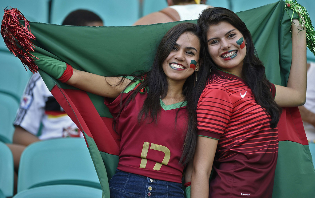 . Portugal fans pose prior to the Group G football match between Germany and Portugal at the Fonte Nova Arena in Salvador during the 2014 FIFA World Cup on June 16, 2014.   AFP PHOTO / ODD ANDERSEN/AFP/Getty Images