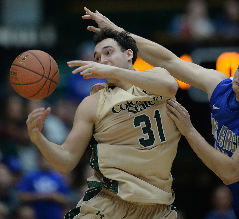 . FORT COLLINS, CO. - JANUARY 18:  Colorado State forward J.J. Avila (31) was fouled in the last minute of the game. The Colorado State men\'s basketball team defeated Air Force 74-68 at Moby Arena in Fort Collins Saturday night, January 18, 2014. Photo By Karl Gehring/The Denver Post