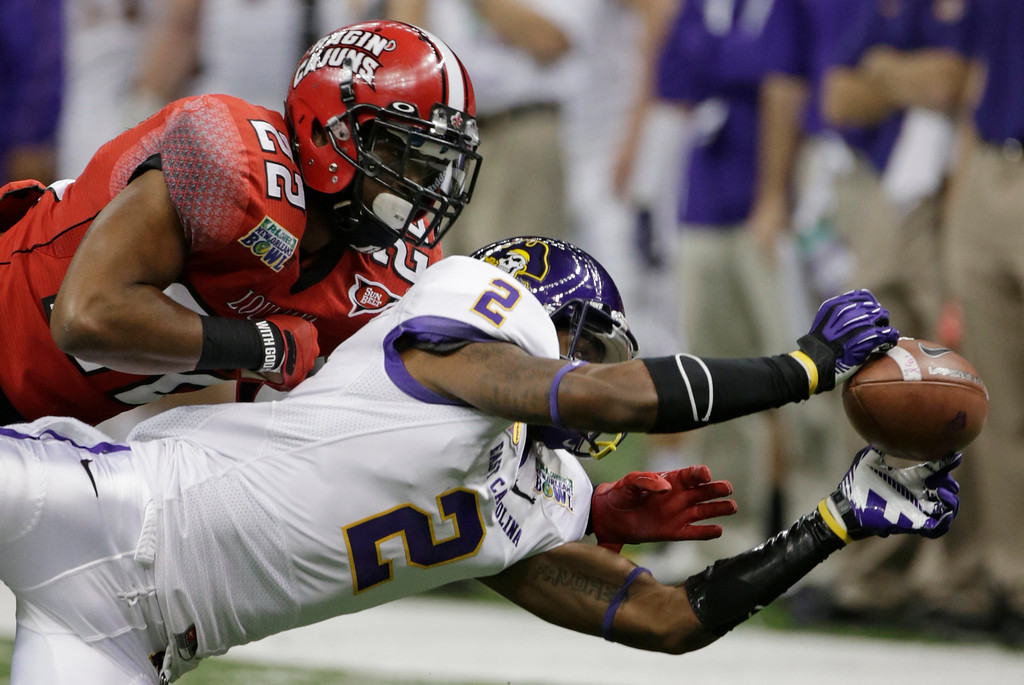 . Louisiana-Lafayette cornerback Melvin White (22) breaks up a pass to East Carolina wide receiver Justin Hardy (2) in the first half of the New Orleans Bowl, an NCAA college football game in New Orleans, Saturday, Dec. 22, 2012. (AP Photo/Dave Martin)