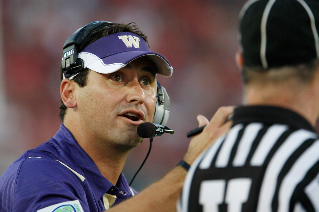 . Washington head coach Steve Sarkisian argues with an official against Stanford in the second quarter of an NCAA football game in Stanford, Calif., Saturday, Sept. 26, 2009. (AP Photo/Paul Sakuma)