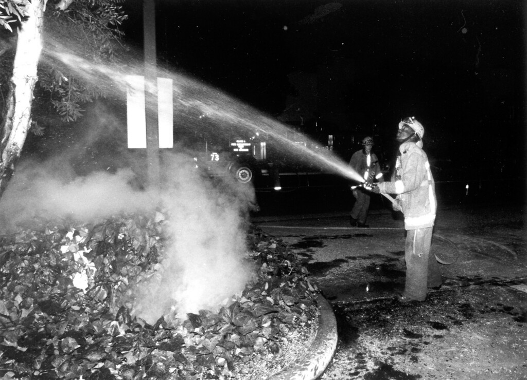 . June 28, 1992: A firefighter hoses down a fire started by fallen electrical wires on Etiwanda near Sherman Way in Reseda on Sunday morning. Daily News file photo