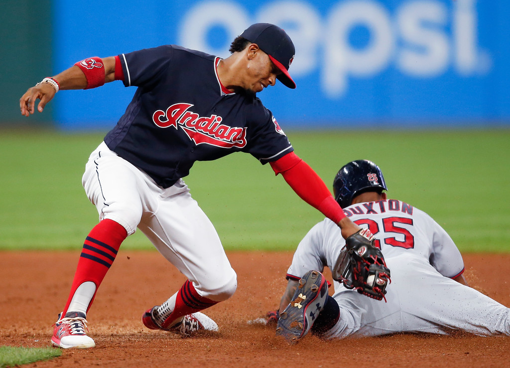 . Minnesota Twins\' Byron Buxton steals second base as Cleveland Indians\' Francisco Lindor tries to apply the tag during the sixth inning in a baseball game, Tuesday, Sept. 26, 2017, in Cleveland. (AP Photo/Ron Schwane)