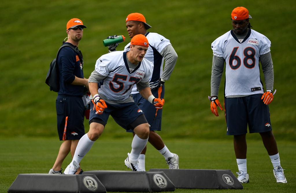 . Denver Broncos Kyle Kragen (57) runs through drills during rookie minicamp May 6, 2016 at UCHealth Training Facility. (Photo By John Leyba/The Denver Post)