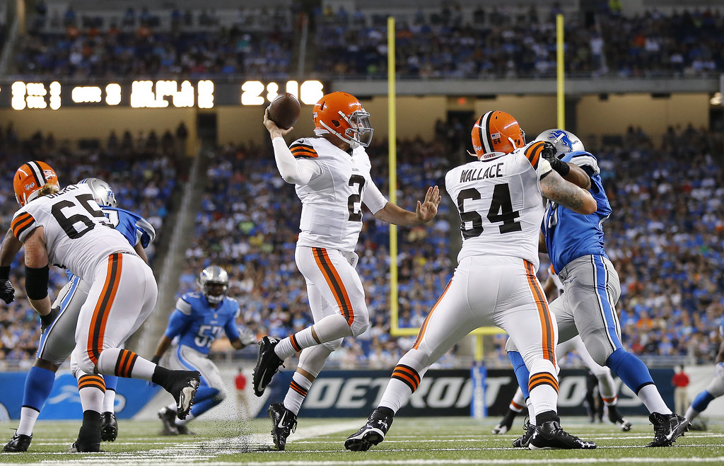 . Cleveland Browns quarterback Johnny Manziel (2) throws against the Detroit Lions in the second half of a preseason NFL football game at Ford Field in Detroit, Saturday, Aug. 9, 2014. (AP Photo/Rick Osentoski)
