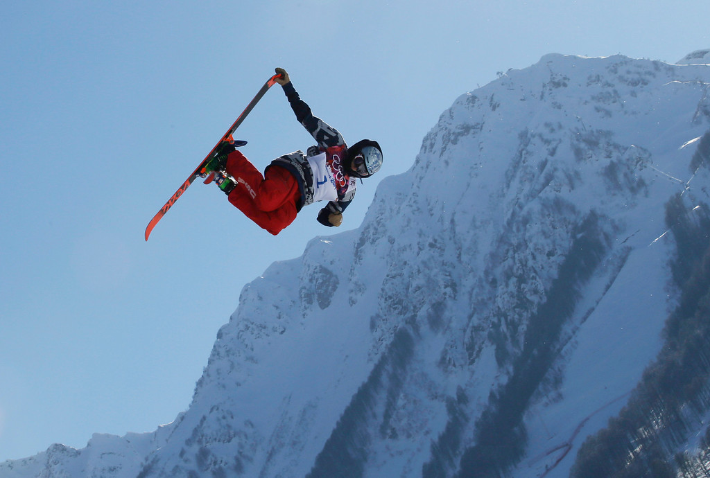 . Nicholas Goepper of the United States takes a jump during a ski slopestyle training session at the Rosa Khutor Extreme Park, prior to the 2014 Winter Olympics, Wednesday, Feb. 5, 2014, in Krasnaya Polyana, Russia. (AP Photo/Andy Wong)