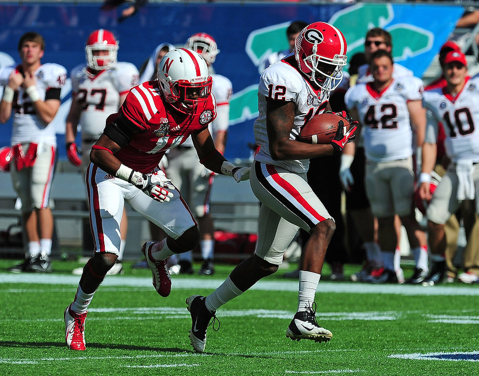 . Tavarres King #12 of the Georgia Bulldogs makes a catch for a touchdown against Andrew Green #11 of the Nebraska Cornhuskers during the Capital One Bowl at the Citrus Bowl on January 1, 2013 in Orlando, Florida. (Photo by Scott Cunningham/Getty Images)