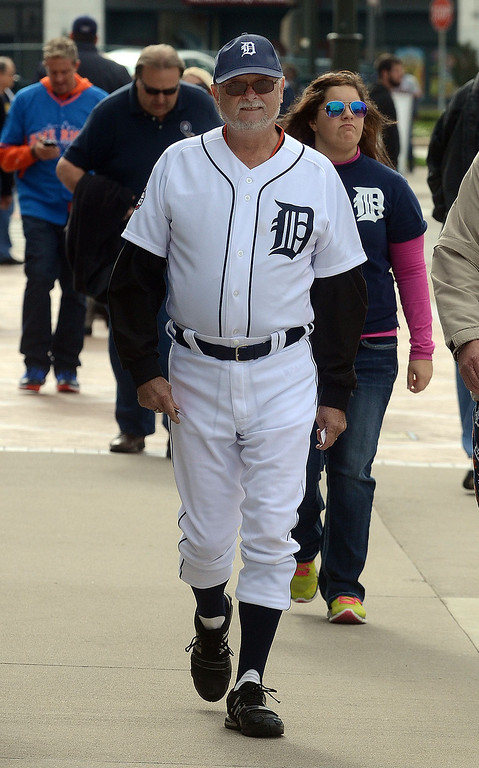 . Gord Wright, of Essex, Ontario, looks like he\'s ready to play in his uniform before heading into Comerica Park for the start of Game 3 of the ALDS between the Tigers and Oakland A\'s, Monday October 7, 2013. (Oakland Press Photo:Vaughn Gurganian)