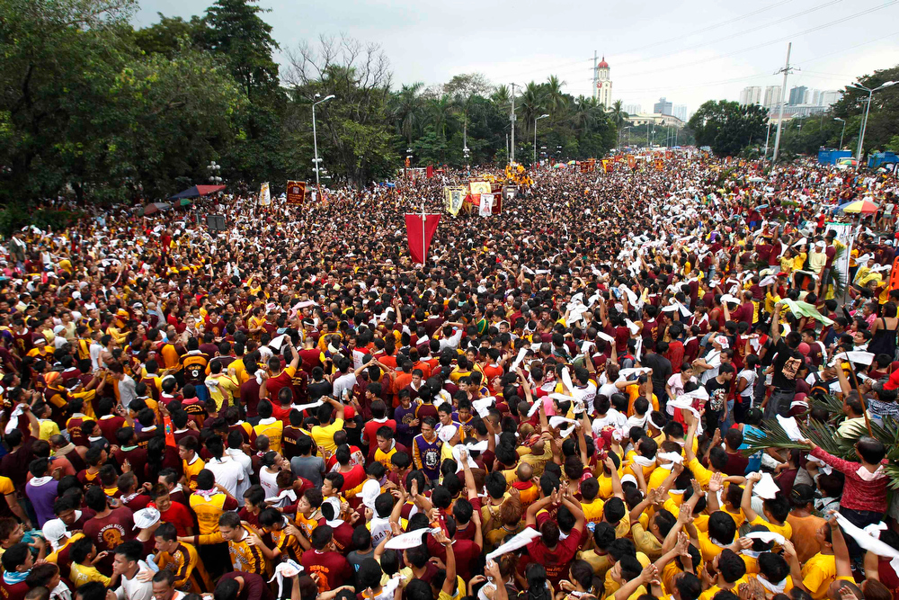 . Tens of thousands of devotees wave white cloths to welcome the Feast of the Black Nazarene during an annual procession in Manila January 9, 2013. The Black Nazarene, a life-size wooden statue of Jesus Christ carved in Mexico and brought to the Philippines in the 17th century, is believed to have healing powers in the predominantly Roman Catholic country. It is paraded through the narrow streets of Manila\'s old city from dawn to midnight. Police said about 500,000 people joined the procession on Wednesday.    REUTERS/Romeo Ranoco