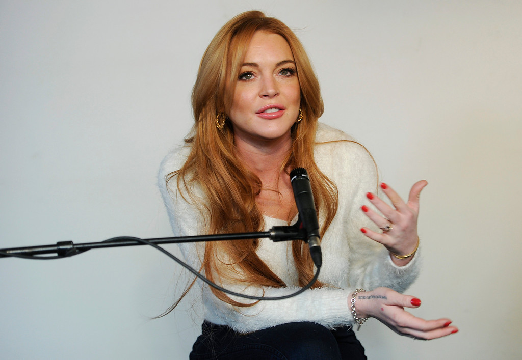""". Actress Lindsay Lohan addresses reporters at a news conference at the 2014 Sundance Film Festival, Monday, Jan. 20, 2014, in Park City, Utah. Producer Randall Emmett and Lohan announced the forthcoming production of a new film, \""""Inconceivable,\"""" in which Lohan will star and co-produce. (Photo by Chris Pizzello/Invision/AP)"""