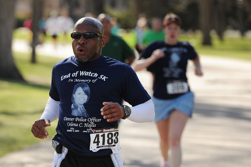 . Teacher John Collins finishes the race.  Family, colleagues, and friends of slain Denver Police Officer Celena Hollis turned out April 7, 2013 for a 5k run and walk to raise money for a scholarship fun and a memorial bench in City Park in Denver, CO.  Over 300 runners and walkers participated in the race that started at 9:00 am.  The race looped around City Park.  After the race, a gathering was held to remember Hollis and 22 white doves were released in her memory.  (Photo By Helen H. Richardson/ The Denver Post)
