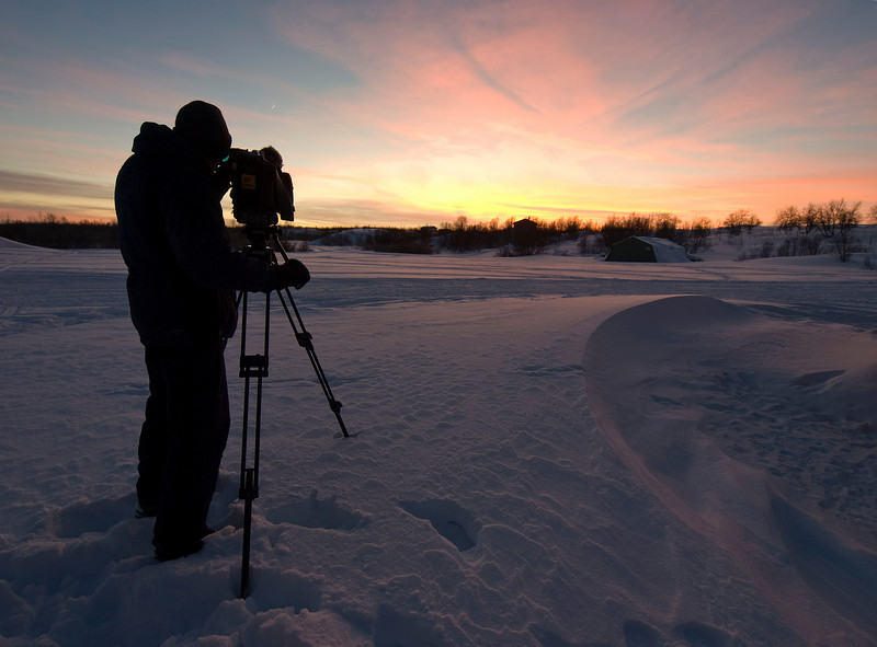 Set. It was dark by 3pm, which felt very strange. With the sun staying so low on the horizon it made for some stunning sunset scenes. Here I worked on getting a silhouette of Al filming, without losing too much of the ground snow. It was all very exciting because as the sun went down the aurora came out to play. Olympus E3, 7-14mm - F4.5, 1/13s, EC +0.3