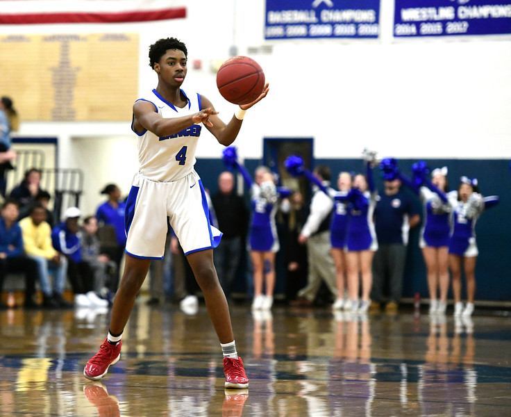 1/18/2019 Mike Orazzi | Staff Bristol Eastern's Jahcyrus LawrenceBynum (4) during Friday night's boys basketball game with Bristol Central at Eastern.